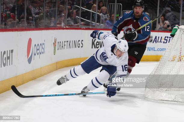 Mitchell Marner of the Toronto Maple Leafs stumbles behind the net while skating against Patrik Nemeth of the Colorado Avalanche at the Pepsi Center...