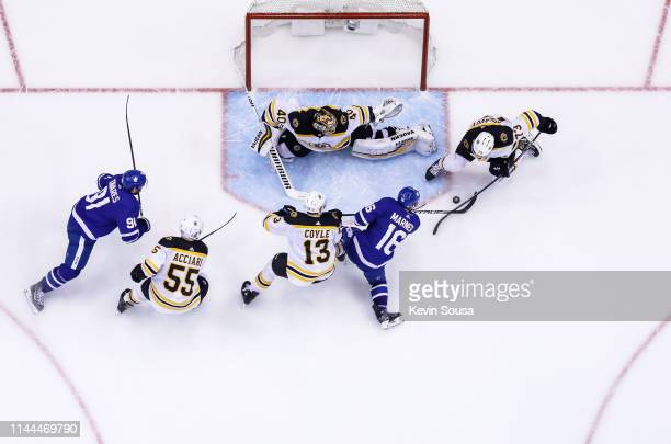 Mitchell Marner of the Toronto Maple Leafs takes a shot against Tuukka Rask of the Boston Bruins during the third period during Game Six of the...