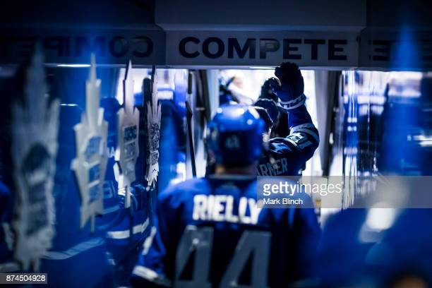 Mitchell Marner of the Toronto Maple Leafs touches the 'compete' sign as he walks to the ice prior to the game against the Boston Bruins at the Air...