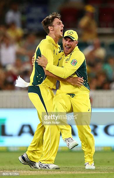 Mitchell Marsh and Aaron Finch of Australia celebrate the final wicket during the Victoria Bitter One Day International match between Australia and...