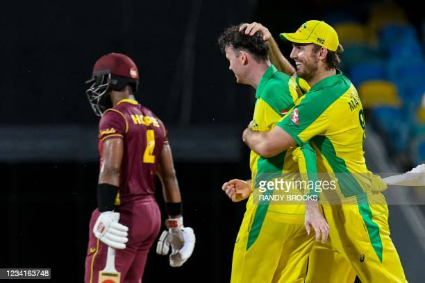 Mitchell Marsh and Ashton Turner of Australia celebrate the dismissal of Shai Hope of West Indies during the 2nd ODI between West Indies and...