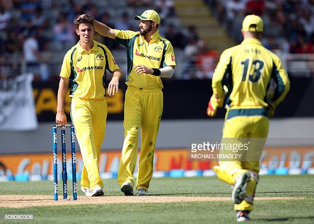 Mitchell Marsh and Kane Richardson of Australia celebrate the wicket of New Zealand's Henry Nicholls during the first oneday international cricket...