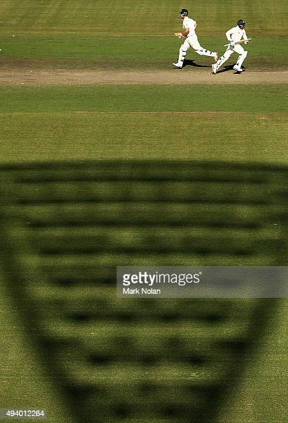 Mitchell Marsh and Usman Khawaja of the CA XI run between wickets during the tour match between the Cricket Australia XI and New Zealand at Manuka...