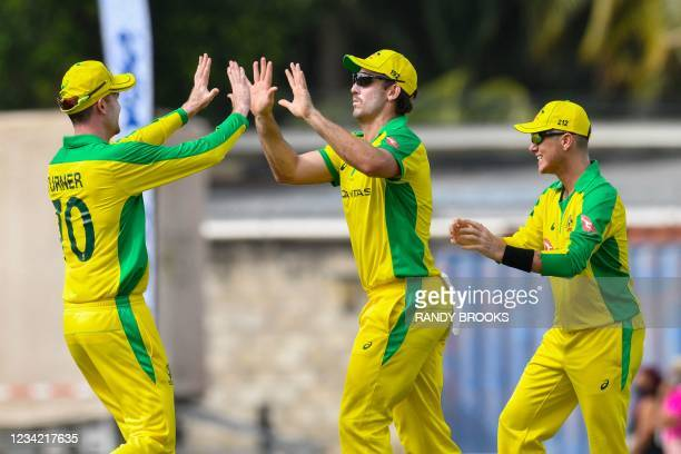 Mitchell Marsh , Ashton Turner and Adam Zampa of Australia celebrate the dismissal of Shai Hope of West Indies during the 3rd and final ODI between...