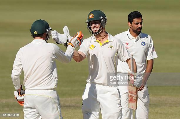 Mitchell Marsh of Australia A celebrates scoring his century with Sam Whiteman during the Quadrangular Series match between Australia A and India A...