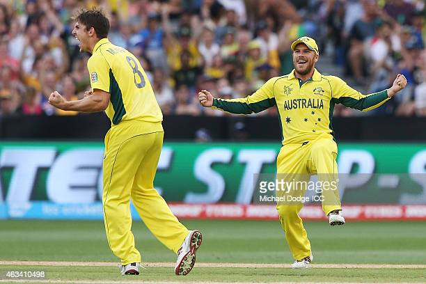 Mitchell Marsh of Australia celebrates a wicket with Aaron Finch of Australia who took the catch during the 2015 ICC Cricket World Cup match between...