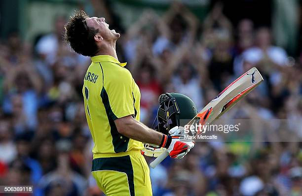 Mitchell Marsh of Australia celebrates after scoring a century during game five of the Commonwealth Bank One Day Series match between Australia and...