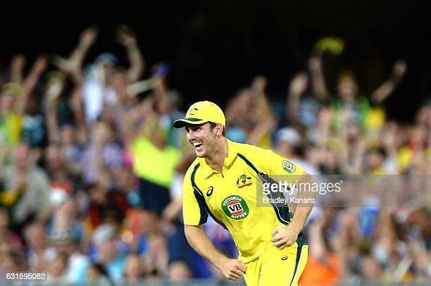 Mitchell Marsh of Australia celebrates after taking a catch to dismiss Mohammad Rizwan of Pakistan during game one of the One Day International...