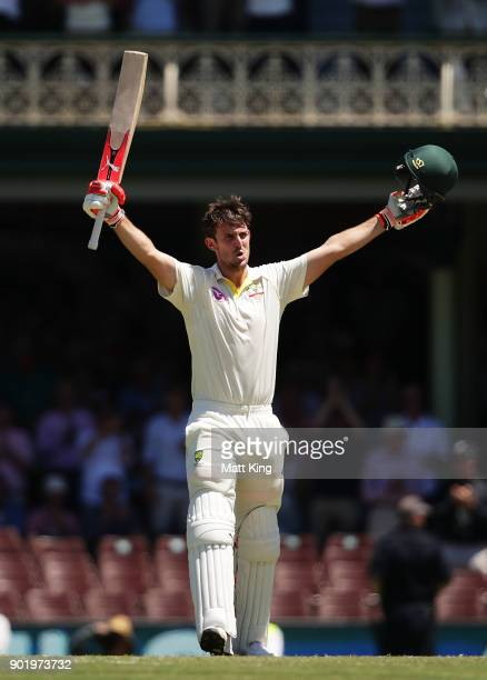Mitchell Marsh of Australia celebrates and acknowledges the crowd after scoring a century during day four of the Fifth Test match in the 2017/18...