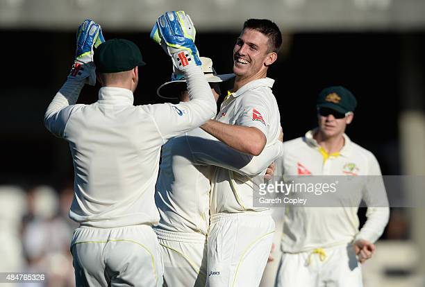 Mitchell Marsh of Australia celebrates dismissing Ben Stokes of England during day two of the 5th Investec Ashes Test match between England and...