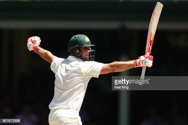 Mitchell Marsh of Australia celebrates scoring a century during day four of the Fifth Test match in the 2017/18 Ashes Series between Australia and...