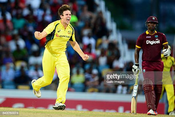 Mitchell Marsh of Australia celebrates the wicket of Darren Bravo of the West Indies during the Tri-Nation Series One-day International Final between...