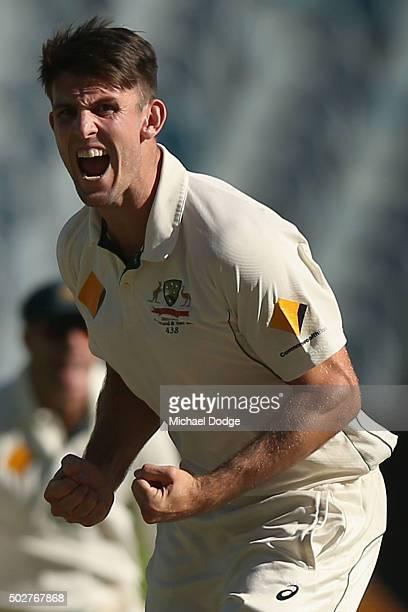 Mitchell Marsh of Australia celebrates the wicket of Jason Holder of the West Indies during day four of the Second Test match between Australia and...