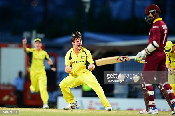 Mitchell Marsh of Australia celebrates the wicket of Marlon Samuels of the West Indies during the TriNation Series Oneday International Final between...