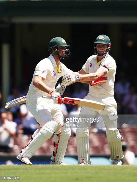 Mitchell Marsh of Australia celebrates with his brother Shaun Marsh of Australia after scoring a century and alerts him to a possible runout during...