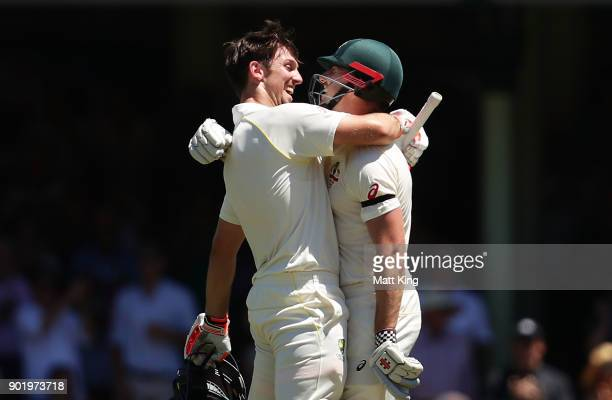 Mitchell Marsh of Australia celebrates with his brother Shaun Marsh of Australia after scoring a century during day four of the Fifth Test match in...