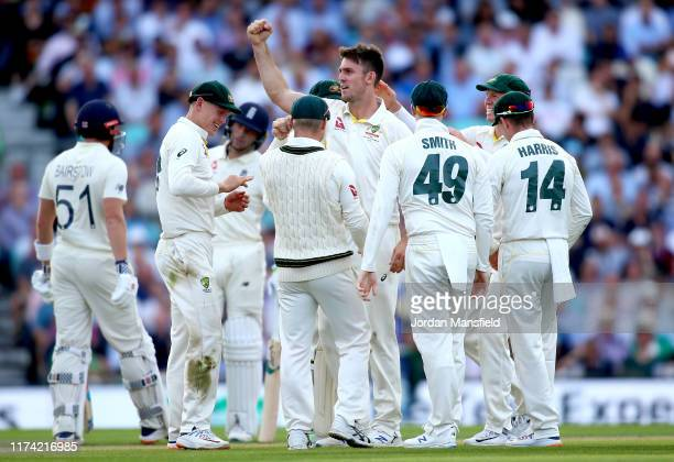 Mitchell Marsh of Australia celebrates with his teammates after dismissing Jonny Bairstow of England during day one of the 5th Specsavers Ashes Test...