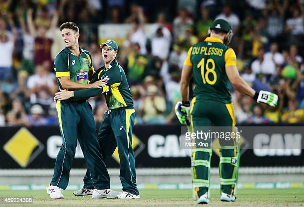Mitchell Marsh of Australia celebrates with Steven Smith after taking the wicket of Faf du Plessis of South Africa during game three of the One Day...