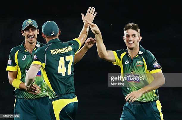 Mitchell Marsh of Australia celebrates with team mates after taking the wicket of Faf du Plessis of South Africa during game three of the One Day...