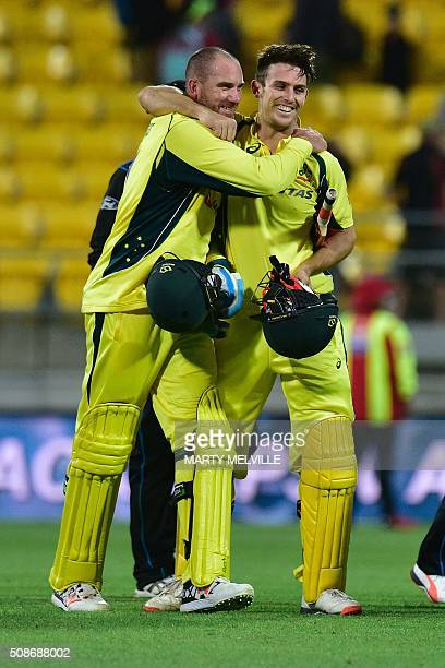 Mitchell Marsh of Australia celebrates with teammate John Hastings as they walk off the field during the second oneday international cricket match...