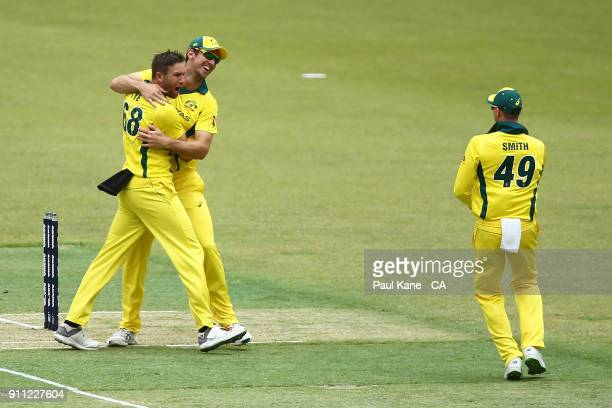 Mitchell Marsh of Australia congratulates Andrew Tye after dismissing Jason Roy of England during game five of the One Day International match...