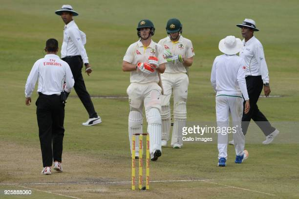 Mitchell Marsh of Australia walks off after bad light stopped play during day 1 of the 1st Sunfoil Test match between South Africa and Australia at...