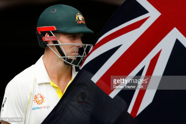 Mitchell Marsh of Australia walks out to bat during day three of the Third Test match in the series between Australia and India at Melbourne Cricket...