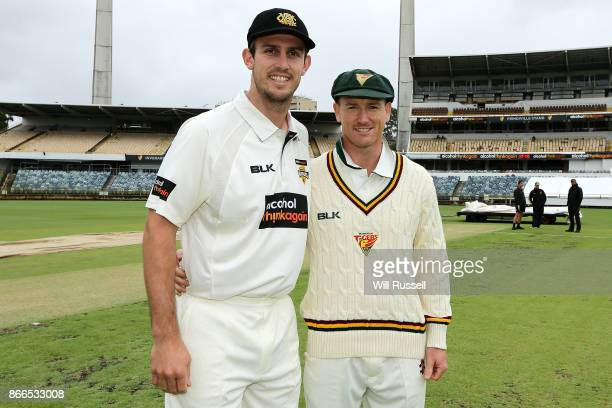Mitchell Marsh of the Warriors and George Bailey of the Tigers after the coin toss during day one of the Sheffield Shield match between Western...
