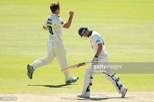 Mitchell Marsh of the Warriors celebrates the dismissal of Tim Paine of the Tigers during day three of the Sheffield Shield match between the Western...