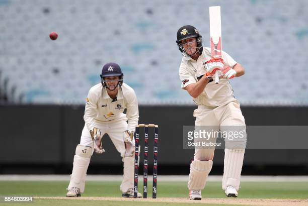 Mitchell Marsh of Western Australia bats as wicketkeeper Seb Gotch of Victoria looks on during day one of the Sheffield Shield match between Victoria...