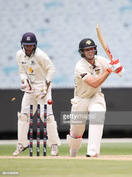 Mitchell Marsh of Western Australia is bowled out by Fawad Ahmed of Victoria during day one of the Sheffield Shield match between Victoria and...