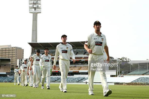 Mitchell Marsh of Western Australia leads his team from the field after being defeated during day four of the Sheffield Shield match between Western...