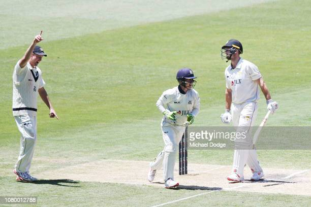 Mitchell Marsh of Western Australia look dejected after his dismissal as Cameron White of Victoria gestures to his depature during day four of the...