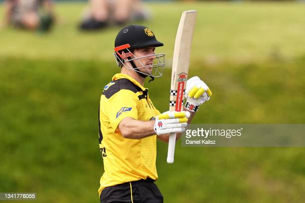 Mitchell Marsh of Western Australia raises his bat after reaching his half century during the Marsh One-Day Cup match between South Australia and...