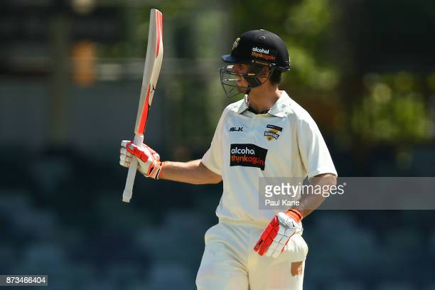 Mitchell Marsh of Western Australia raises his bat to the rooms after his half century during day one of the Sheffield Shield match between Western...