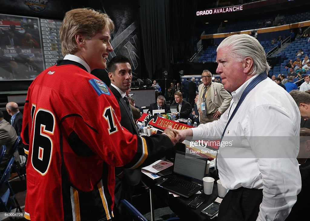 Mitchell Mattson greets President of Hockey Operations Brian Burke after being selected 126th overall by the Calgary Flames during the 2016 NHL Draft at First Niagara Center on June 25, 2016 in Buffalo, New York.