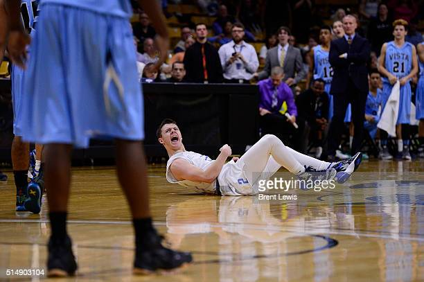 Mitchell Mayber of Pueblo West screams after hitting the floor during the third quarter at the Coors Events Center on March 11 2016 in Boulder...