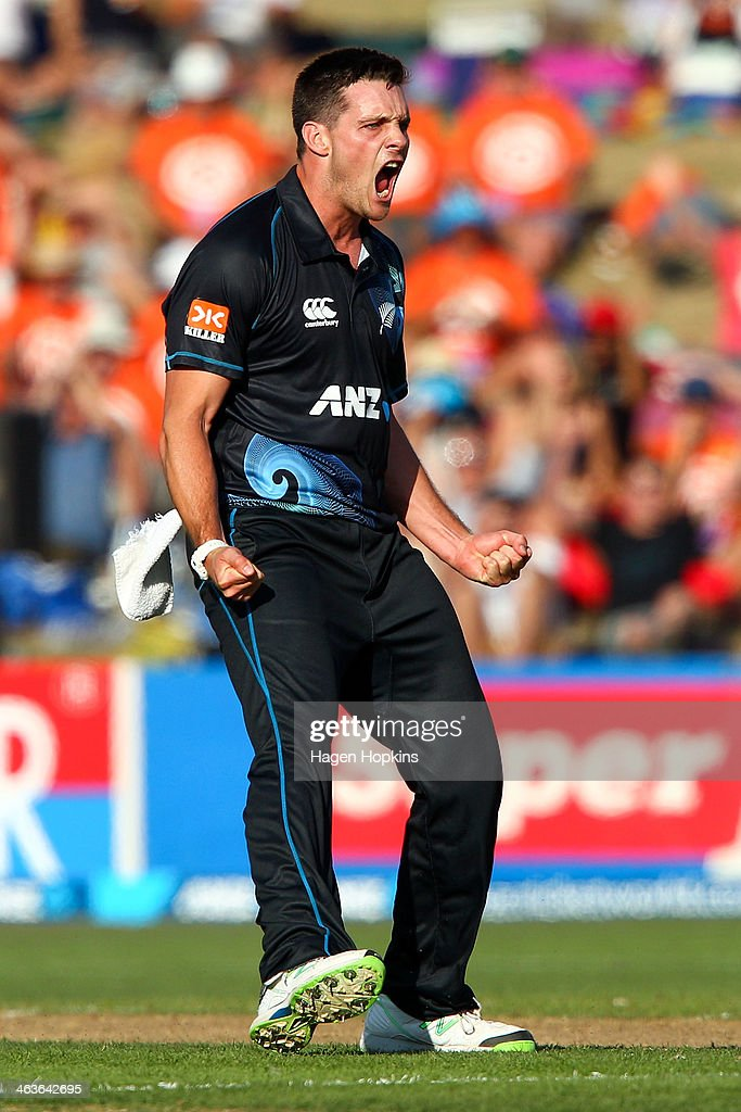 Mitchell McClenaghan of New Zealand celebrates after taking the wicket of Rohit Sharma of India during the first One Day International match between New Zealand and India at McLean Park on January 19, 2014 in Napier, New Zealand.