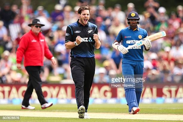 Mitchell McClenaghan of New Zealand celebrates after taking the wicket of Lahiru Thirimanne during the second One Day International game between New...