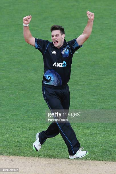 Mitchell McClenaghan of New Zealand celebrates the wicket of Dwayne Bravo of the West Indies during the first One Day International match between New...