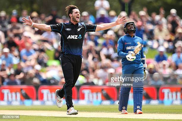Mitchell McClenaghan of New Zealand celebrates the wicket of Milinda Siriwardena of Sri Lanka while Chamara Kapugedera of Sri Lanka looks on in...