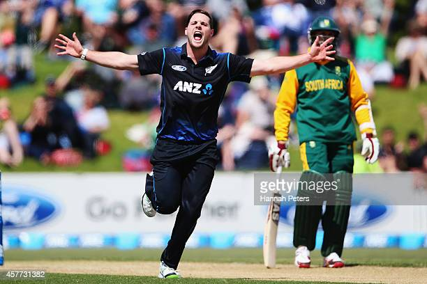 Mitchell McClenaghan of New Zealand celebrates the wicket of Quinton de Kock of South Africa during the One Day International match between New...