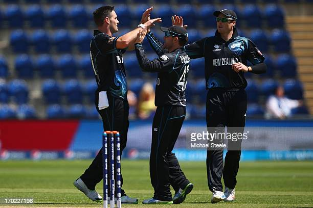 Mitchell McClenaghan of New Zealand celebrates with Brendon McCullim and Martin Guptill after taking the wicket of Lasith Malinga of Sri Lanka during...