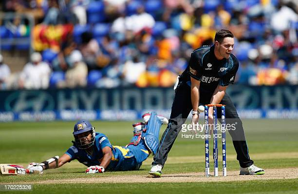 Mitchell McClenaghan of New Zealand fumbles a chance to run out Lahiru Thirimanne of Sri Lanka during the ICC Champions Trophy group A match between...