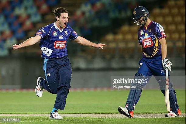 Mitchell McClenaghan of the Aces celebrates the wicket of Anaru Kitchen of the Volts during the Georgie Pie Super Smash Final match between the...