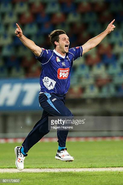 Mitchell McClenaghan of the Aces celebrates the wicket of Neil Broom of the Volts during the Georgie Pie Super Smash Final match between the Auckland...
