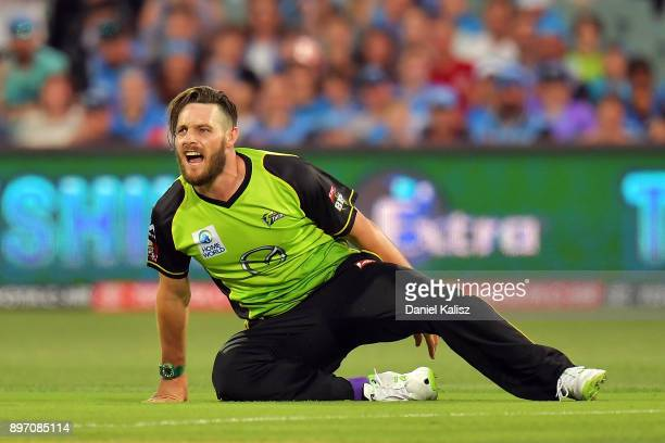 Mitchell McClenaghan of the Sydney Thunder reacts after colliding with Jake Weathered of the Adelaide Strikers during the Big Bash League match...