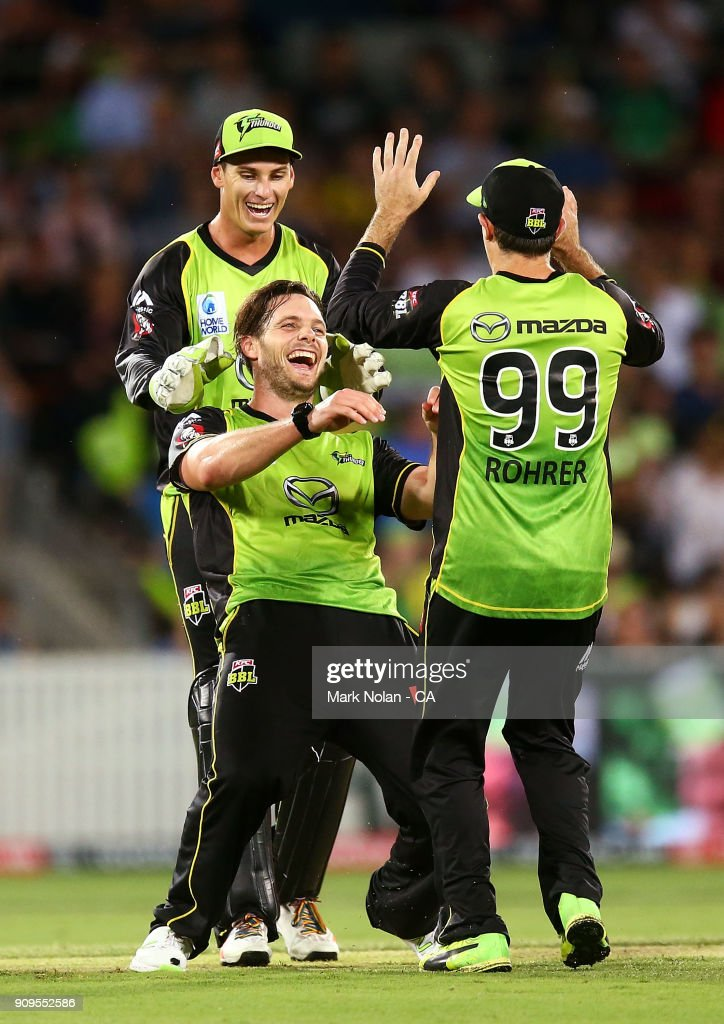 Mitchell McClenaghan of the Thunder celebrates getting the wicket of Dwayne Bravo of the Renegades during the Big Bash League match between the Sydney Thunder and the Melbourne Renegades at Manuka Oval on January 24, 2018 in Canberra, Australia.