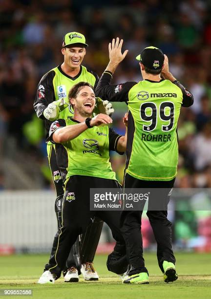Mitchell McClenaghan of the Thunder celebrates getting the wicket of Dwayne Bravo of the Renegades during the Big Bash League match between the...