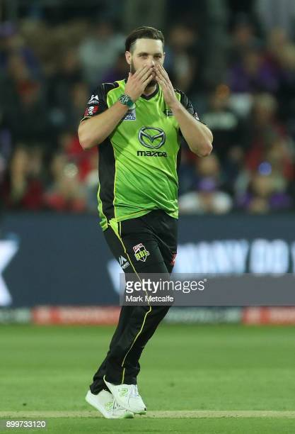 Mitchell McClenaghan of the Thunder celebrates taking ta wicket during the Big Bash League match between the Hobart Hurricanes and the Sydney Thunder...